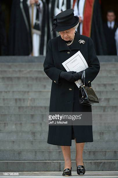 Queen Elizabeth II departs the Ceremonial funeral of former British Prime Minister Baroness Thatcher at St Paul's Cathedral on April 17, 2013 in...