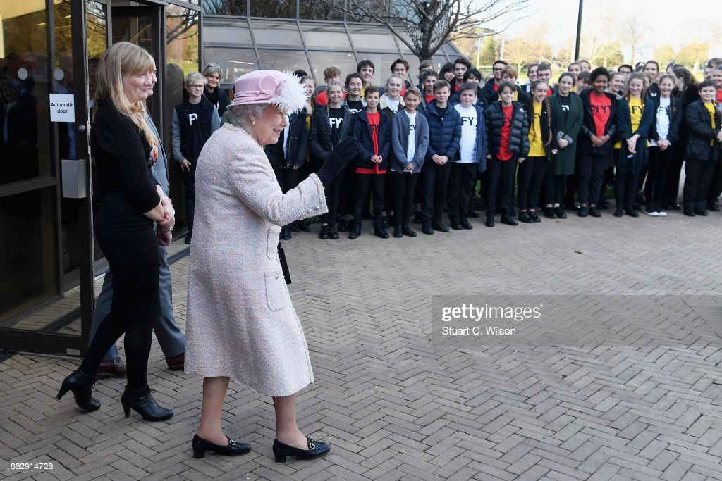 Queen Elizabeth II departs the Chichester Theatre while visiting West Sussex on November 30, 2017 in Chichester, United Kingdom.