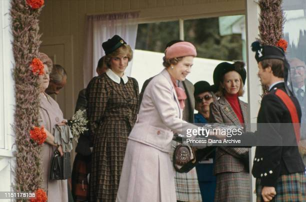 Queen Elizabeth II, Diana, Princess of Wales and the Queen Mother at the Braemar Highland Games in Scotland, September 1982. Diana is wearing a suit...