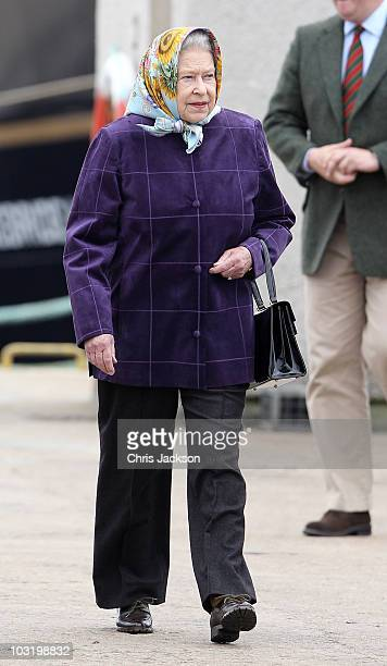 Queen Elizabeth II disembarks the Hebridean Princess with other members of the Royal Family in Scrabster Harbour on August 2, 2010 in Scrabster,...