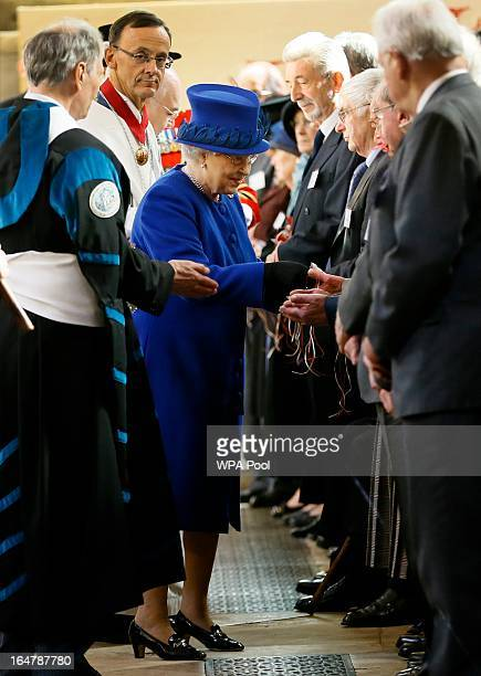 Queen Elizabeth II distributes Maundy money during the Maundy service at Christ Church Cathedral on March 28 2013 in Oxford England The Maundy money...