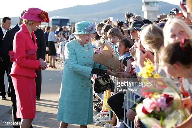 Queen Elizabeth II does a walkabout with Governor-General Quentin Bryce on October 19, 2011 in Canberra, Australia. The Queen and Duke of Edinburgh...