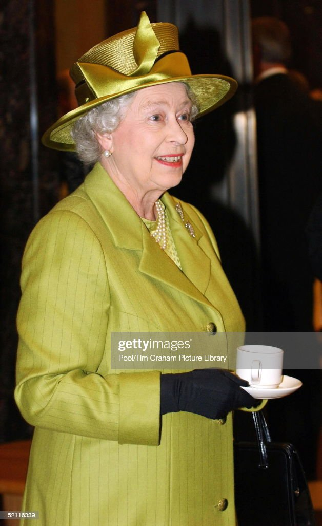 Queen Elizabeth II Drinking Tea During Her Visit To The Newly Refurbished Ministry Of Defence Building In Whitehall, London. The Queen Is Wearing A Hat Designed By Milliner, Philip Somerville With A Suit By Karl-ludwig Rehse.