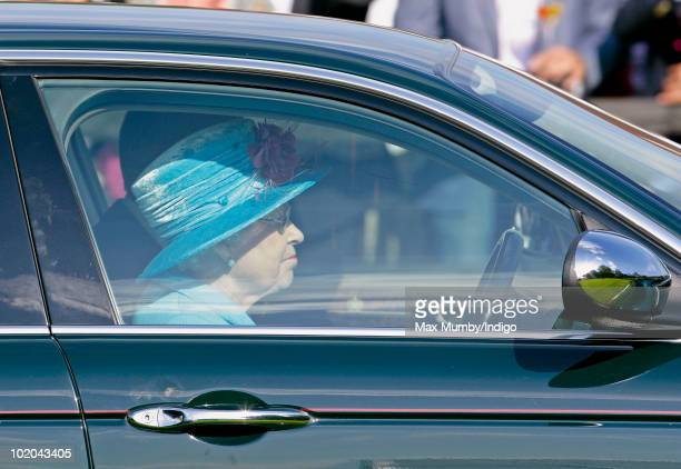 HM Queen Elizabeth II drives her Jaguar car as she leaves after watching the the final of the Harcourt Developments Queen's Cup polo tournament at...
