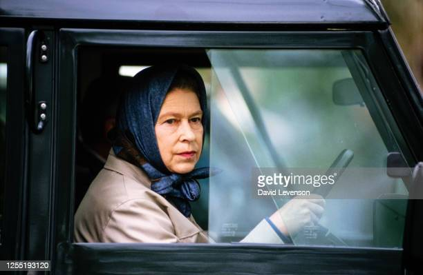 """Queen Elizabeth II drives her Land Rover at the Windsor Horse Show, in Windsor, Berkshire on May 10, 1986. """"n"""