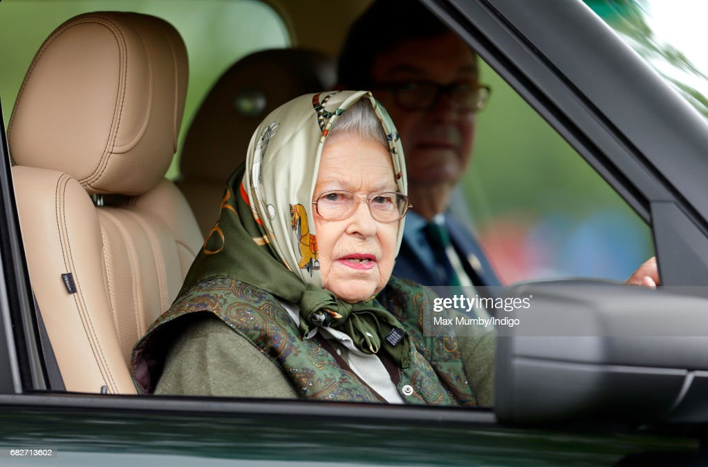 Queen Elizabeth II drives her Range Rover car as she attends day 4 of the Royal Windsor Horse Show in Home Park on May 13, 2017 in Windsor, England.