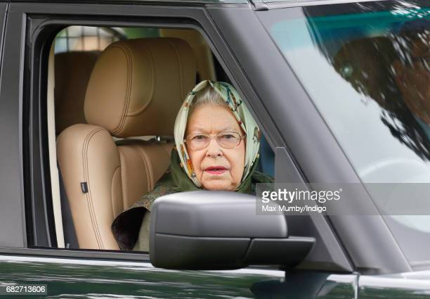 Queen Elizabeth II drives her Range Rover car as she attends day 4 of the Royal Windsor Horse Show in Home Park on May 13 2017 in Windsor England