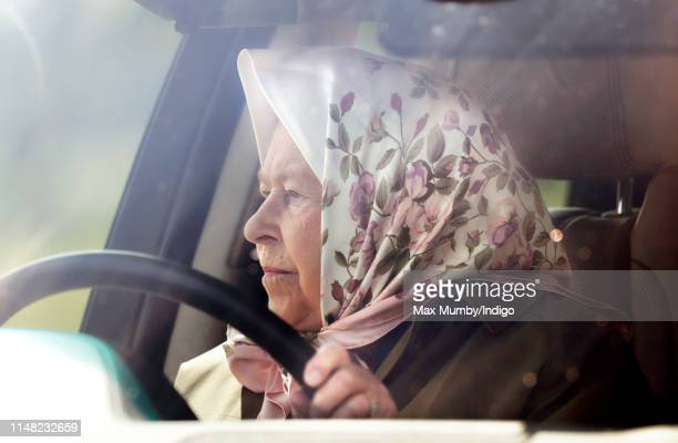 Queen Elizabeth II drives herself in her Range Rover car as she attends day 3 of the Royal Windsor Horse Show in Home Park on May 10, 2019 in...