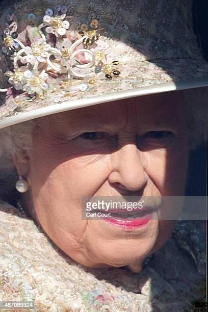 Queen Elizabeth II drives to attend a service at Crathie Kirk Church on September 6, 2015 in Crathie, Aberdeenshire. Queen Victoria began worshipping...