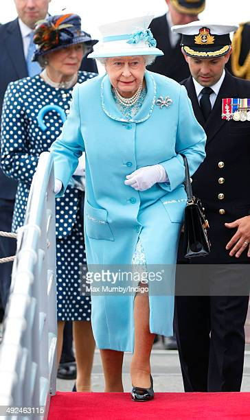 Queen Elizabeth II Duke of Lancaster disembarks HMS Lancaster following a visit to the ship at Portsmouth Naval Base on May 20 2014 in Portsmouth...