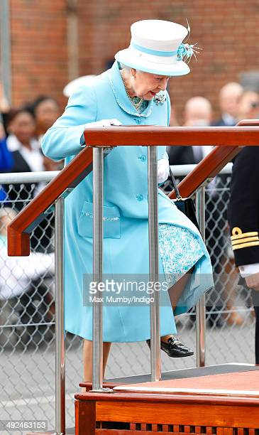 Queen Elizabeth II Duke of Lancaster steps onto a dais to take a salute as she visits HMS Lancaster at Portsmouth Naval Base on May 20 2014 in...