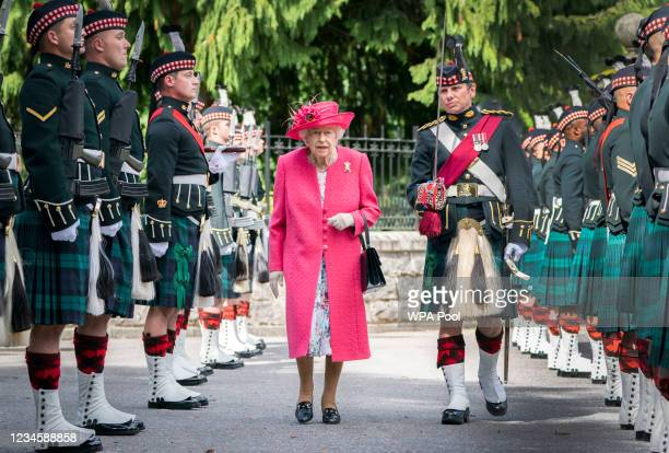 Queen Elizabeth II during an inspection of the Balaklava Company, 5 Battalion The Royal Regiment of Scotland at the gates at Balmoral, as she takes...