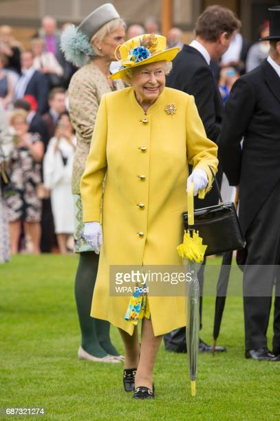 Queen Elizabeth II during the garden party at Buckingham Palace on May 23 2017 in London England A minute's silence was observed for the victims of...