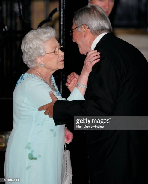 HM Queen Elizabeth II embraces King Constantine of Greece as she leaves his 70th birthday party at Crown Prince Pavlos of Greece's residence on June...