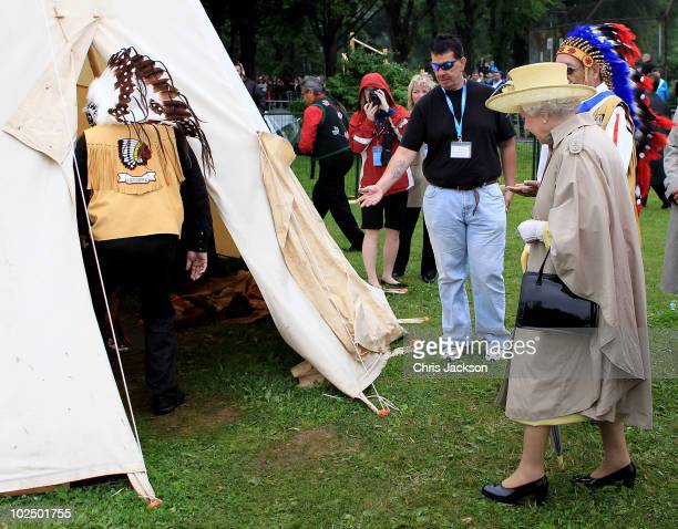 Queen Elizabeth II enters a wigwam as she attends a Mi�kmaq event at Halifax Common on June 28 2010 in Halifax Canada The Queen and Duke of Edinburgh...