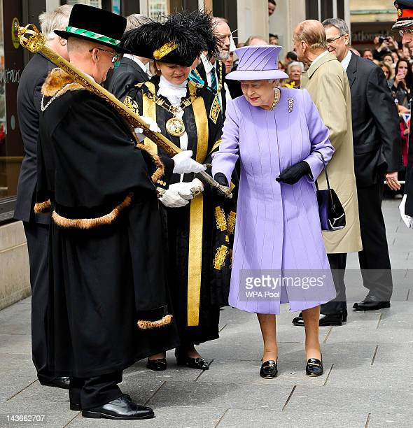 Queen Elizabeth II examines a ceremonial sword during a visit to Exeter city centre on May 02 2012 in Exeter England The Queen and Duke of Edinburgh...