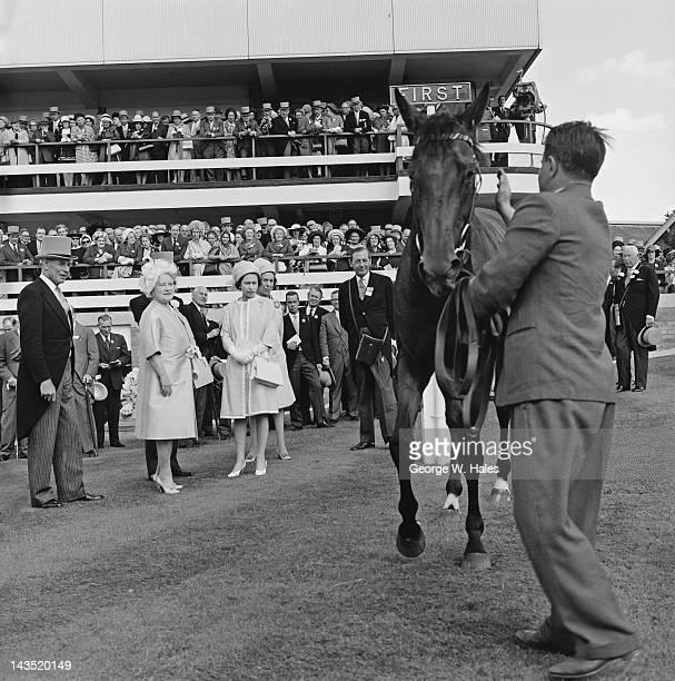 Queen Elizabeth II examines her horse Hopeful Venture in the unsaddling enclosure after it won the Hardwicke Stakes on the last day of Royal Ascot...