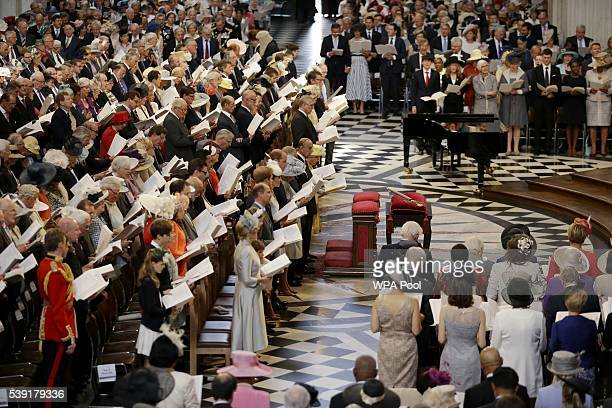 Queen Elizabeth II flanked by her husband Prince Philip and the congregation sing during a service of thanksgiving for Queen Elizabeth II's 90th...