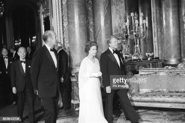 Queen Elizabeth II flanked by President Jimmy Carter and President Giscard d'Estaing in the Blue Drawing Room at Buckingham Palace where world...