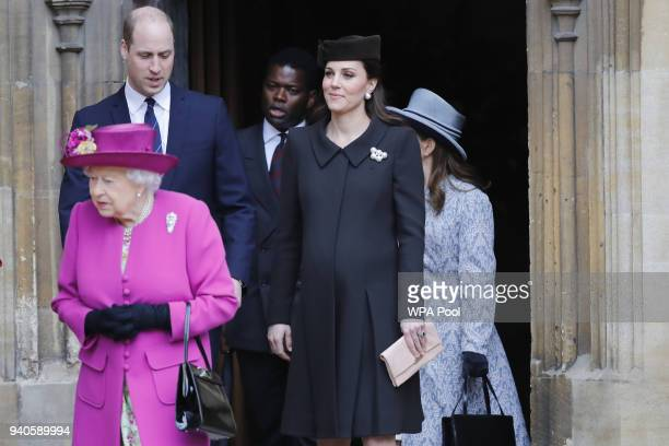 Queen Elizabeth II followed by Prince William, Duke of Cambridge and Catherine, Duchess of Cambridge exit after the Easter Mattins Service at St....