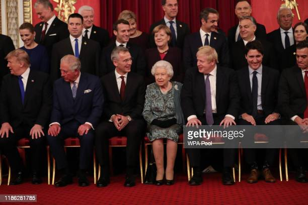 Queen Elizabeth II German Chancellor Angela Merkel and Prime Minister Boris Johnson join other Nato leaders for a group photograph at a reception for...