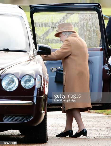 Queen Elizabeth II gets into her Bentley car after attending Sunday service at the Church of St Mary Magdalene on the Sandringham estate on January...