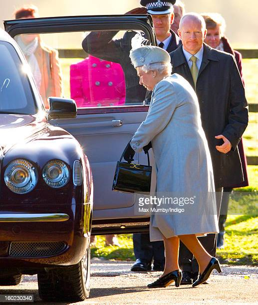 Queen Elizabeth II gets into her Bentley car as she leaves St Mary Magdalene Church Sandringham after attending Sunday service along with Prince...