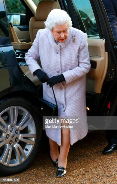 Queen Elizabeth II gets out of her Range Rover car as she arrives to attend a meeting of the Sandringham branch of the Women's Institute of which she...