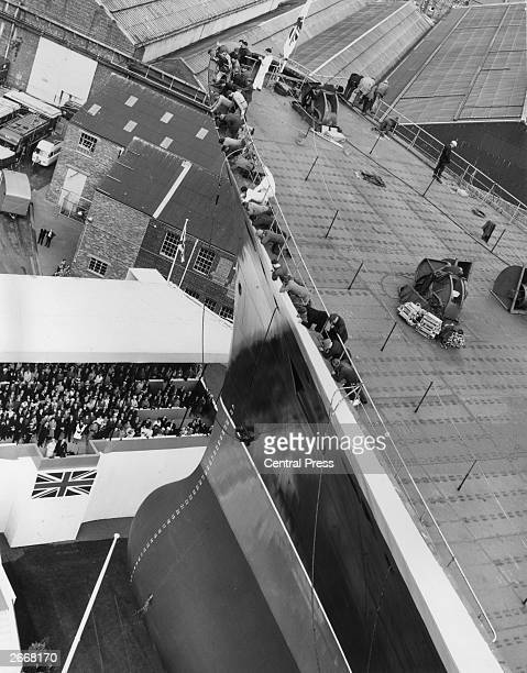Queen Elizabeth II gives her name to the new £30 million Cunard liner on the day of its launch at the John Brown Co shipyard Clydebank Shipyard...