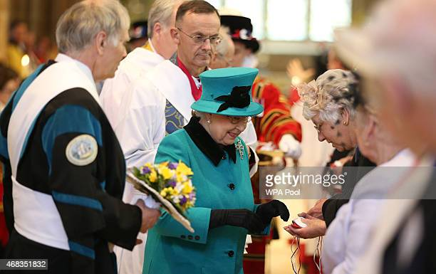Queen Elizabeth II gives out Royal Maundy money during the Traditional Royal Maundy Service at Sheffield Cathedral on April 2 2015 in Sheffield...