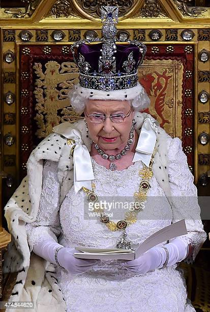 Queen Elizabeth II gives the Queen's Speech from the throne in the House of Lords next to Prince Philip, Duke of Edinburgh during the State Opening...