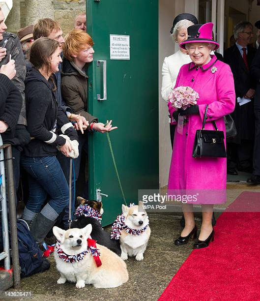 Queen Elizabeth II greest well wishers with corgis during a visit to Sherborne Abbey on May 1 2012 in Sherborne England The Queen and Duke of...