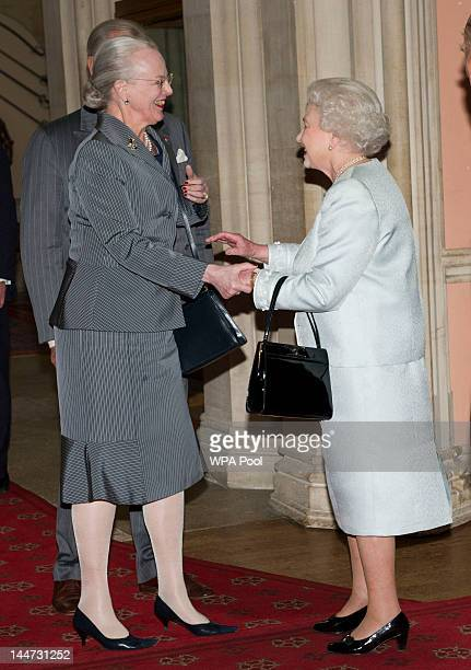 Queen Elizabeth II greet Queen Margrethe of Denmark as she arrives at a lunch for Sovereign Monarch's held in honour of Queen Elizabeth II's Diamond...