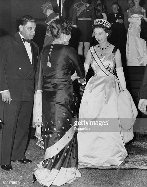 Queen Elizabeth II greeting one of the guests at a state banquet in Karachi during a Commonwealth visit to Pakistan 2nd February 1961 The banquet is...