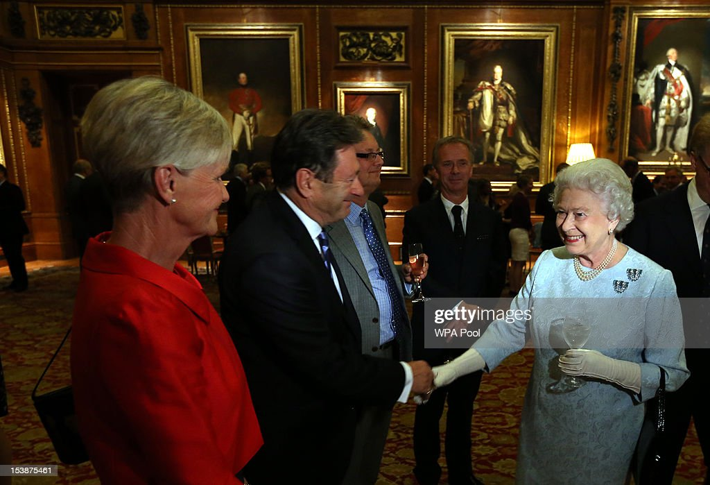 Queen Elizabeth II greets Alison (left) and Alan Titchmarch at a reception for the participants of the Royal Windsor Horse Show Jubilee Pageant which was held in May, at Windsor Castle on October 10, 2012 in Windsor, England.