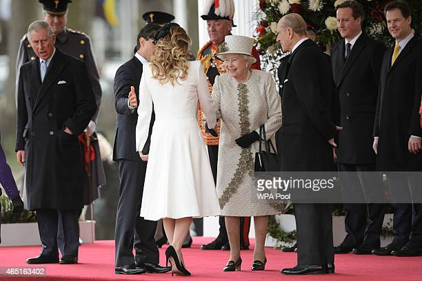 Queen Elizabeth II greets Angelica Rivera, wife of Mexican President Enrique Pena Nieto, during a Ceremonial Welcome at Horse Guards Parade on March...