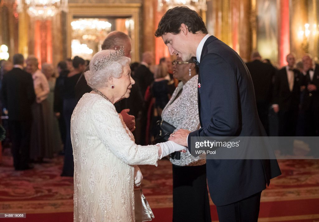Queen Elizabeth II greets Canada's Prime Minister Justin Trudeau in the Blue Drawing Room at The Queen's Dinner during the Commonwealth Heads of Government Meeting (CHOGM) at Buckingham Palace on April 19, 2018 in London, England.