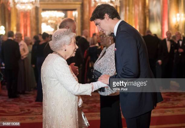 Queen Elizabeth II greets Canada's Prime Minister Justin Trudeau in the Blue Drawing Room at The Queen's Dinner during the Commonwealth Heads of...