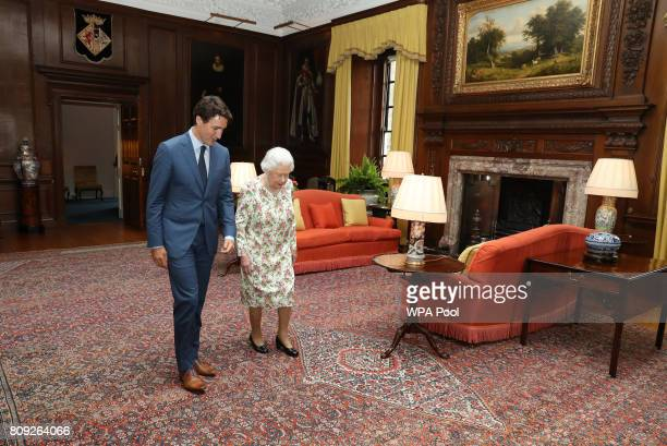 Queen Elizabeth II greets Canadian Prime Minister Justin Trudeau during an audience at the Palace of Holyroodhouse in Edinburgh Scotland