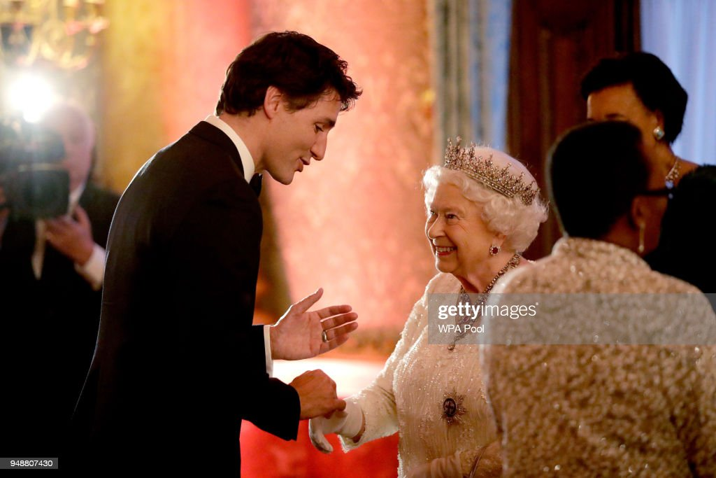 Queen Elizabeth II greets Canadian Prime Minister Justin Trudeau in a receiving line for the Queen's Dinner for the Commonwealth Heads of Government Meeting (CHOGM) at Buckingham Palace on April 19, 2018 in London, England.