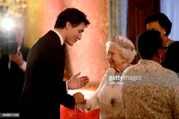 Queen Elizabeth II greets Canadian Prime Minister Justin Trudeau in a receiving line for the Queen's Dinner for the Commonwealth Heads of Government...