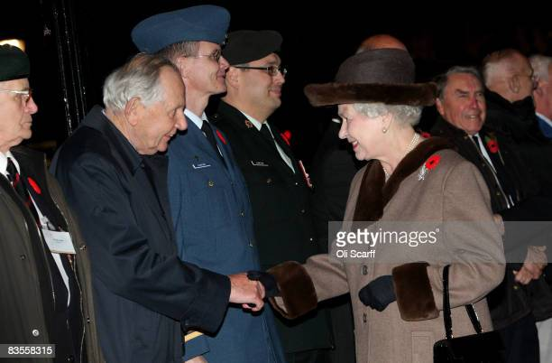 Queen Elizabeth II greets Canadian veterans of World War II and currently serving servicemen as she arrives at Canada House Trafalgar Square on...