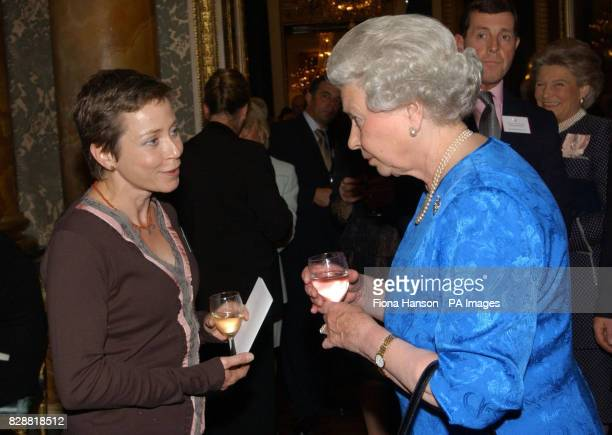 Queen Elizabeth II greets cancer sufferer Jane Tomlinson at a reception at Buckingham London which aims to pay tribute to more than 400 pioneers of...