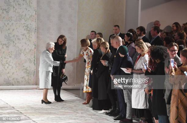 Queen Elizabeth II greets Chief Executive of the British Fashion Council Caroline Rush and Anna Wintour as she attends the Richard Quinn show during...