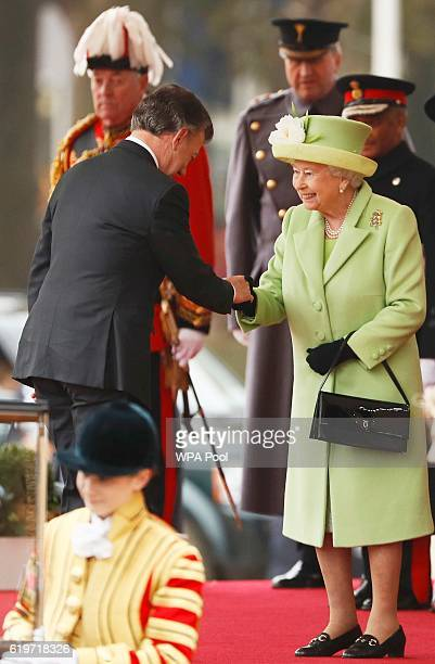 Queen Elizabeth II greets Colombia's President Juan Manuel Santos at a ceremonial welcome for Colombia's President Juan Manuel Santos and his wife...