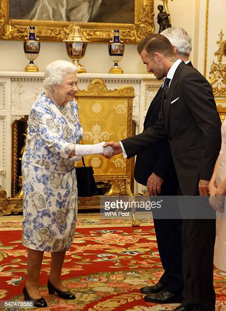 Queen Elizabeth II greets David Beckham as he attends the Queen's Young Leaders Awards at Buckingham Palace on June 23 in London United Kingdom