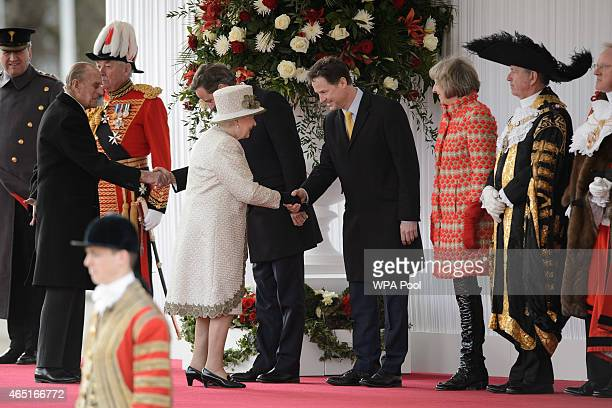 Queen Elizabeth II greets Deputy Prime Minister Nick Clegg as they await the arrival of Mexican President Enrique Pena Nieto and his wife Angelica...