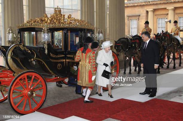 Queen Elizabeth II greets Dr Abdullah Gül the President of the Republic of Turkey steps from the Royal Carriage as she arrives at Buckingham Palace...