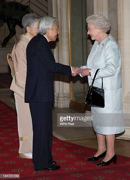 Queen Elizabeth II greets Emperor Akihito of Japan and Empress Michiko as they arrive at a lunch for Sovereign Monarch's held in honour of Queen...