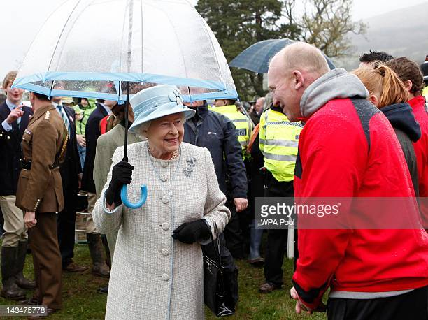 Queen Elizabeth II greets former Welsh rugby player Gareth Jenkins as she visits the Diamonds In The Park festival at Glanusk Park on April 27 2012...